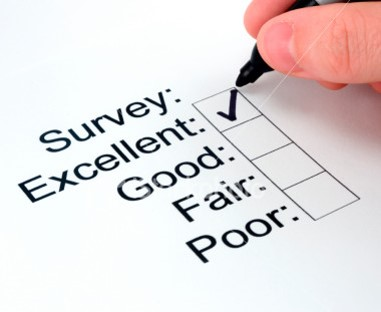 "Close-up of survey response form with person checking the ""excellent"" choice."