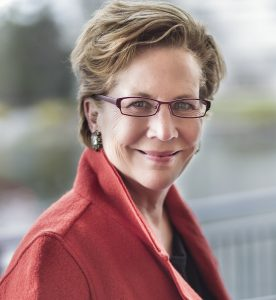 Jane O. Smit Headshot in a Red Jacket