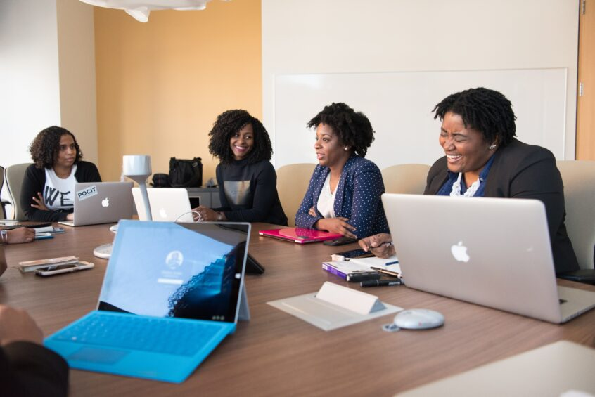team sitting at conference table. Photo by Christina Morillo from Pexels